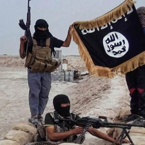 An image made available on a jihadist website during the summer of 2014 which shows Islamic State of Iraq and the Levant militants holding the organization's trademark flag in Iraq. (Photo: AFP)