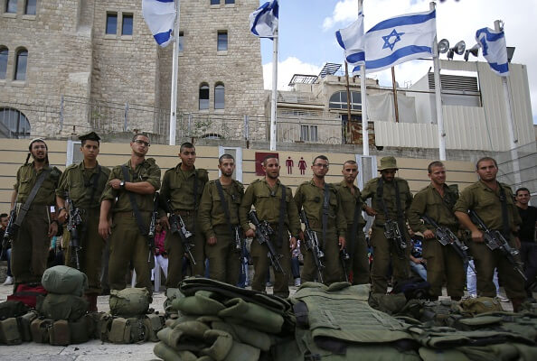 Israeli soldiers stand near the al-Aqsa mosque compound, Islam's third holiest site, on October 30, 2014 after Israeli authorities temporarily closed the compound. (Photo: GALI TIBBON/AFP/Getty Images)