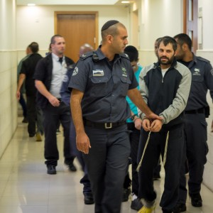 Yosef Haim Ben-David leaving district court in Jerusalem where he is on trial for the murder of Mohammed Abu Khdeir, October 20, 2014. (Photo: Dan Cohen)