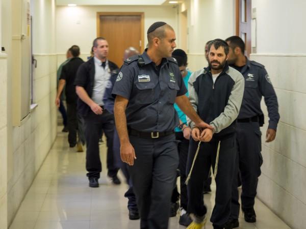 Yosef Haim Ben-David leaving district court in Jerusalem where he is on trial for the murder of Mohammed Abu Khdeir, October 20, 2014. (Photo: Dan Cohen)