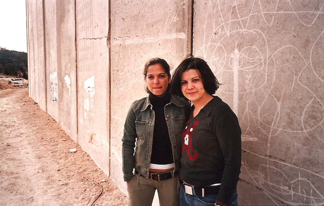 Gal (l) is out of uniform for her meeting at the wall with Rezan, from My So-Called Enemy