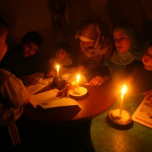 Gaza students study by candle light.