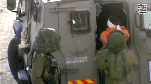 Screen shot: B'tselem Israeli Soldiers detain developmentally-disabled Palestinian child in Hebron, 19 Oct. 2014