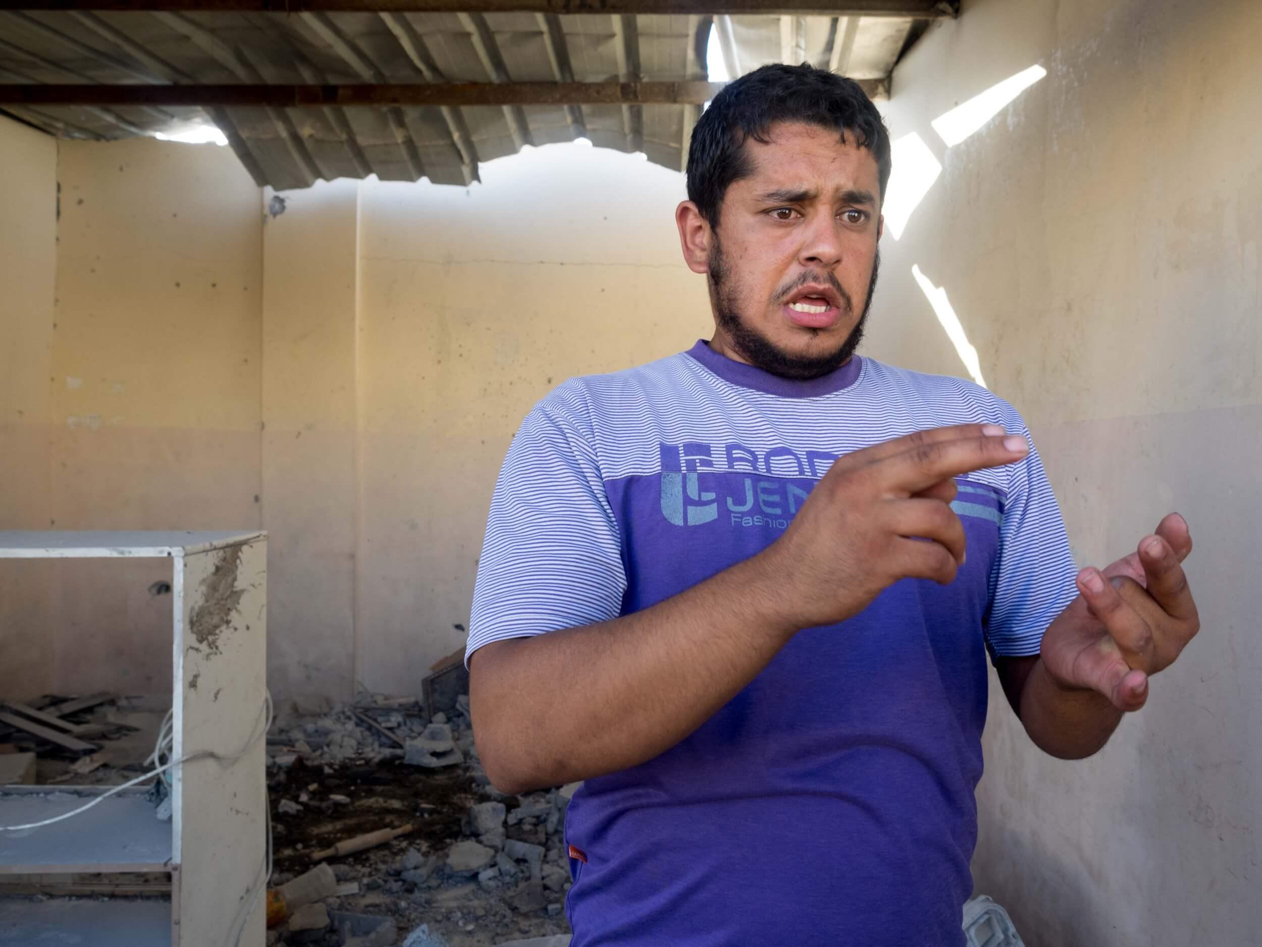 Saleem al Qasas counts his family members killed by Israeli drone strikes. (Photo: Dan Cohen)