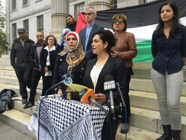 Lawyer Lamis Deek, flanked by Nerdeen Kiswani to her right, says that Kiswani was the victim of a hate crime at the Barclays Center. (Photo: ELI ROSENBERG/NEW YORK DAILY NEWS)