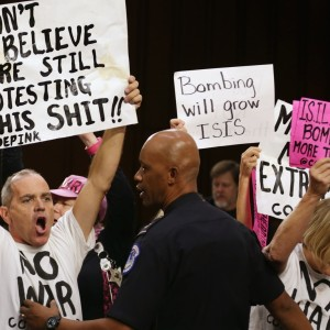 Protesters from CODEPINK interrupted a hearing on the war against ISIS. (Photo: Chip Somodevilla/Getty Images)