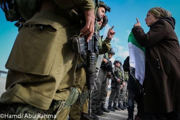 Blocking the Jericho road colonial road to Jerusalem November 28, 2014 (Photo: Hamde Abu Rahma)