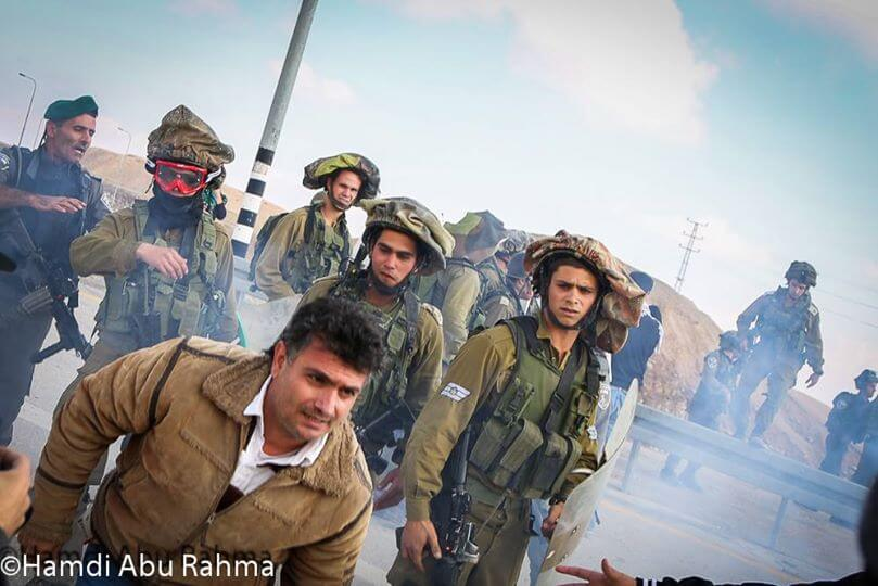 Blocking the Jericho road colonial road to Jerusalem November 28, 2014 (Photo: Hamde Abu Rahma)