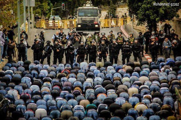 Muslims pray outside the gates of the Noble Sanctuary prevented entrance by Israeli forces.  Jerusalem,  November 3, 2014 (Photo: Mohammed Qzzaz)
