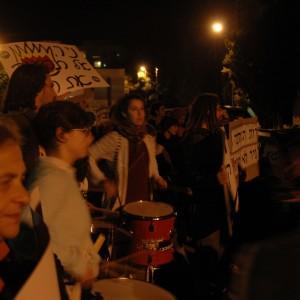 Protesters play drums outside of Jerusalem Mayor Nir Barkat's house. (Photo: Sarah Levy)