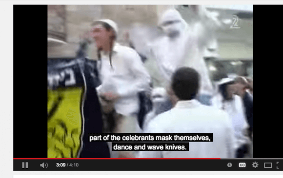 "Screen shot ""Celebrants mask themselves wave and dance with knives"""