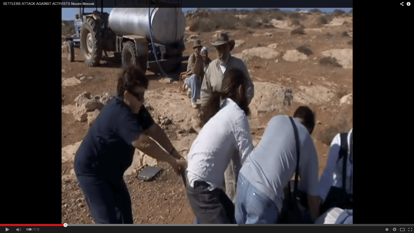 Screenshot of Tzvia Thier pulling a settler's pants, 2010