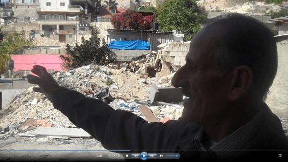 abu Diab Silwan, before a demolished house