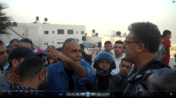 Omar Attiya remonstrating with Israeli officer, Issawiya demonstration, Nov. 12, 2014