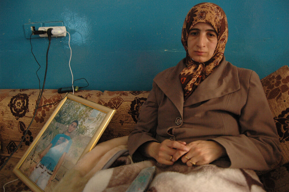 Enas al-Shaludi in her living room, hours after Israeli authorities demolish her son's home and ransack hers. (Photo: Allison Deger)