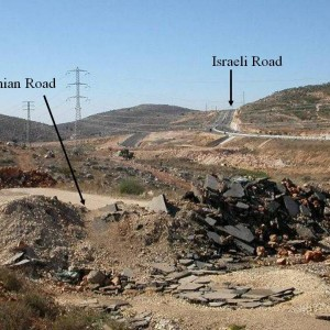 Segregated roads: the 4-lane highway in the background is for Israelis; the unusable blocked road in the foreground is for Palestinian Christians & Muslims. (Photo: International Women's Peace Service via Jews for Justice for Palestinians)