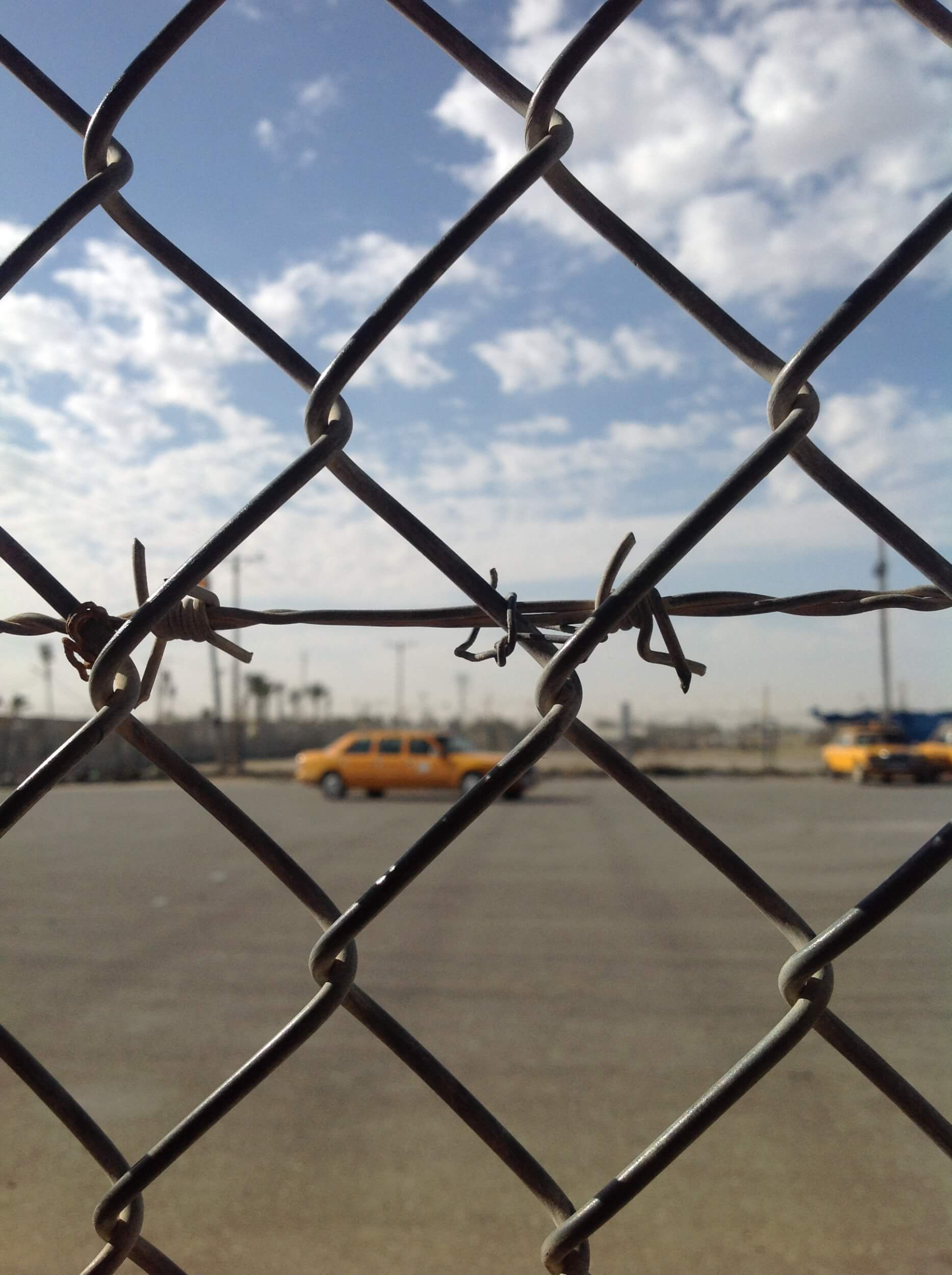 Rafah crossing: it is only a metal fence which hinders me looking at the horizon of life outside Gaza. (Photo: Alaa Radwan)