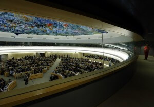 A staff walks in a corridor during the 26th session of the Human Rights Council at the United Nations in Geneva (Photo: Reuters)