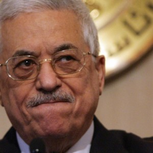 Palestinian leader Mahmoud Abbas holds a
