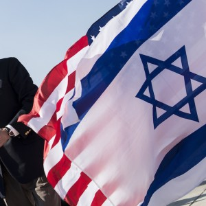US Secretary of State John Kerry walks past American (back) and Israeli flags at Ben Gurion International Airport in Tel Aviv on January 6, 2014. (Photo: Brendan Smialowski/AFP/Getty Images)