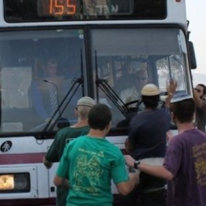 File image of a settler attack on a bus from Radio Bethlehem 2000, at IMEMC