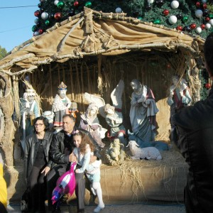 Palestinian family poses for photographs with a life size nativity scene in Bethlehem, December, 42, 2014. (Photo: Allison Deger)