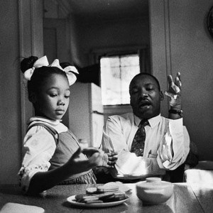 "Martin Luther King explaining to his daughter Yolanda why she could not go to Funtown. ""One of the most painful experiences I have ever faced was to see her tears when I told her Funtown was closed to colored children, for I realized the first dark cloud of inferiority had floated into her little mental sky."" (photo: James Karales)"