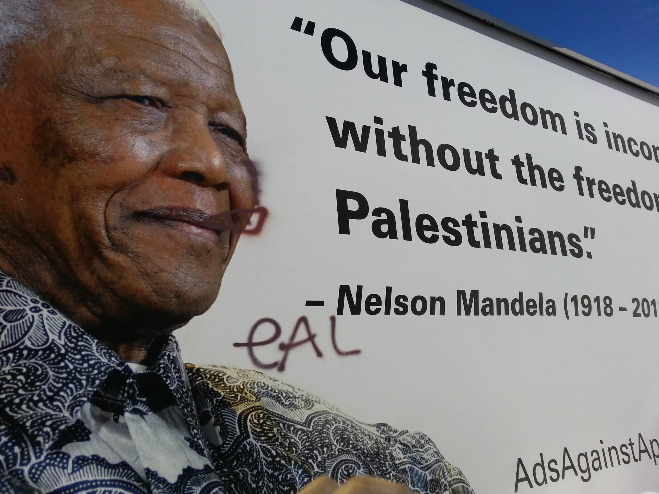 Graffiti on Mandela ad