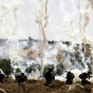 Israeli soldiers firing teargas in West Bank protest in 2008
