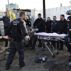 Israeli police officers carry on a stretcher a Palestinian man who stabbed up to 10 people in Tel Aviv January 21, 2015. (Photo: Oren Ziv/Reuters)