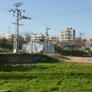 Settler synagogue tent erected on Mr Abdul Karim Al Jaabari's land adjacent the illegal Jewish settlement of Kiryat Arba, 2011 (photo:  Joint Public Issues Team)