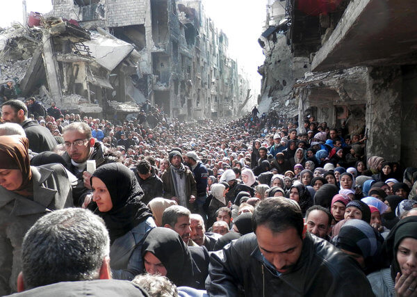 A gargantuan line of starving refugees in Yarmouk waiting for food aid. The authenticity of this photo has been confirmed by both the UN and image forensics specialists. (Photo: UNRWA/AP)