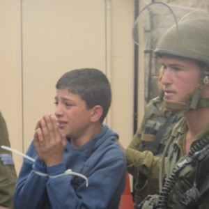 Palestinian child detained in Hebron, posted by Int'l Solidarity Movement