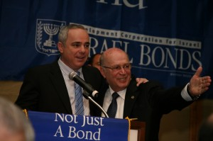 Israeli Finance Minister Yuval Steinitz (left) and Israel Bonds President and CEO Joshua Matza (right) at the 2011 Israel Bonds ceremony in which Alan Bomstein was awarded the Theodor Herzl Commemorative Medallion (Photo: Robbie Cohen / The American Israelite)