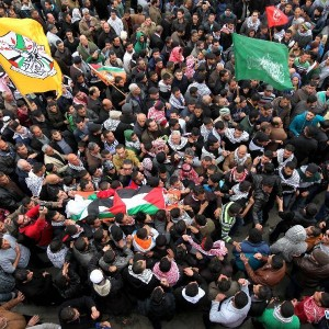 Palestinians carry the body of Jihad al-Jaafari during his funeral in Dheisheh refugee camp in the West Bank city of Bethlehem, on Feb. 24, 2015. Jihad al-Jaafari was shot dead by Israeli soldiers on Tuesday during a raid in the refugee camp. (Photo: Xinhua/Luay Sababa)