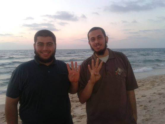 Ayman Alnaouq shown with the friend who was killed with him by an F16. They are holding up the Rabia sign used by protesters, activists and politicians who oppose the recent coup d'état in Egypt, which was led by then-General Abdel Fattah el-Sisi causing the ouster of President Mohamed Morsi.