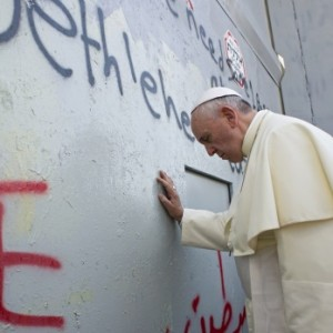 Pope Francis touches the Separation Wall in the West Bank city of Bethlehem May 25, 2014.