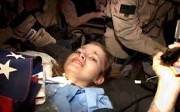"Still from video of special forces ""rescuing"" Private Jessica Lynch. Image: Associated Press"