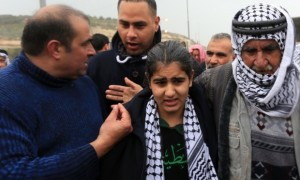 14-year-old Malak al-Khatib (center) with her father (right), just after being released from Israeli prison CREDIT: Emad Drimly/Xinhua Press/Corbis