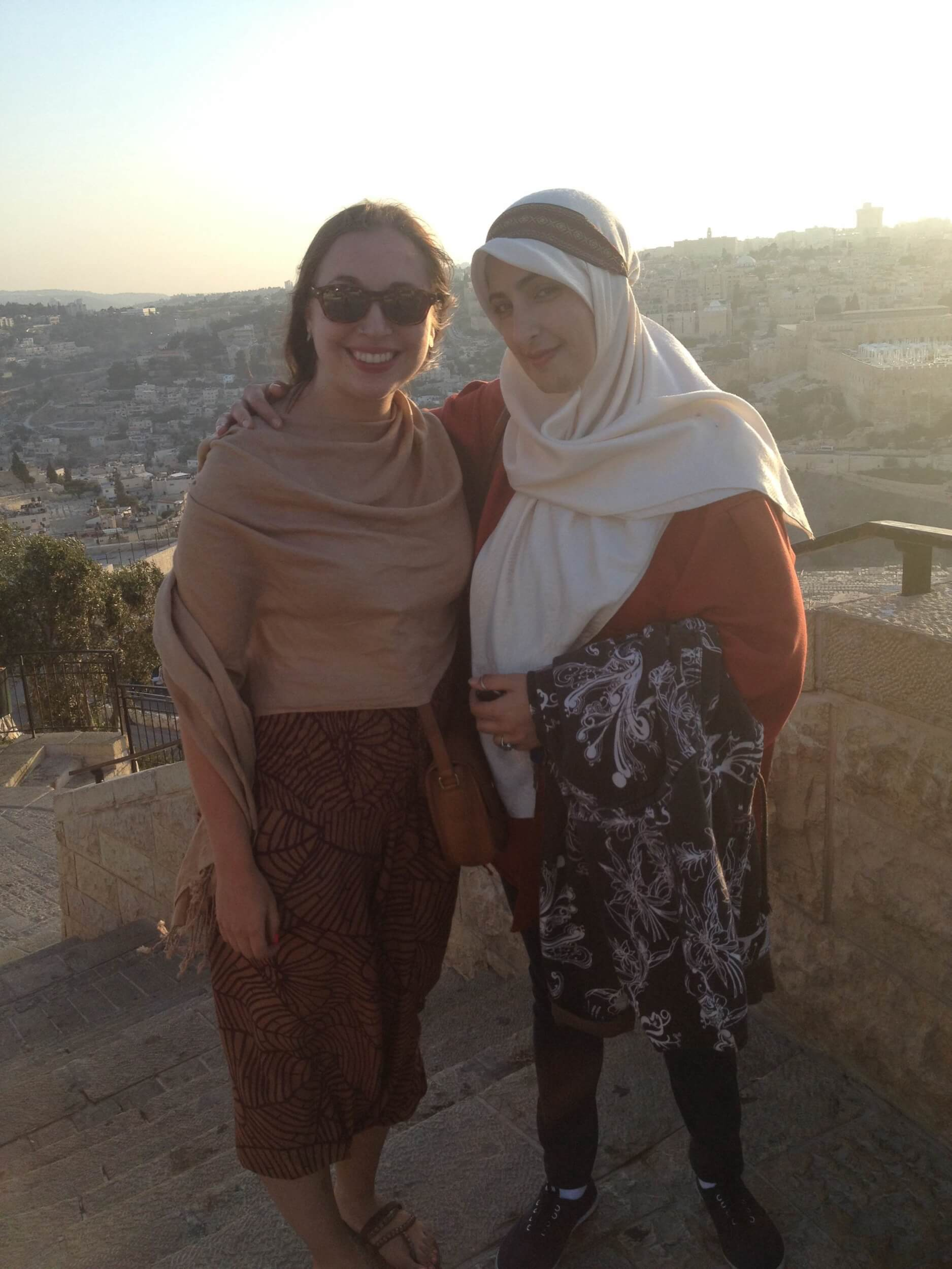 Fatima and Kayla Blau look over Jerusalem on top of the Mount of Olives.  When Fatima was a child, her family used to celebrate weddings and birthdays at the hotel on top of Mount of Olives, and the area was primarily a Palestinian settlement. The hotel is now under Israeli ownership, and the face of the mountain is now an Israeli Defense Forces (IDF) memorial site.