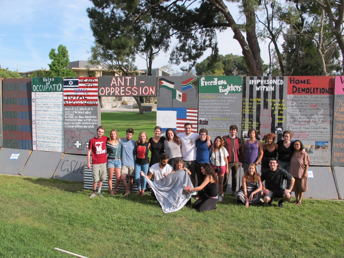 Pitzer Students for Justice in Palestine with the mock Israeli apartheid wall. (Photo: Pitzer Students for Justice in Palestine)