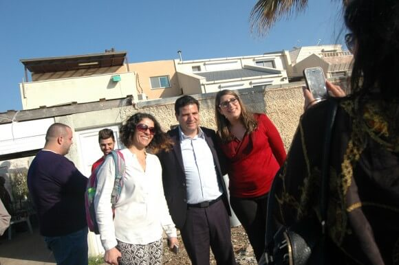 Head of the Joint Arab List, Ayman Odeh, poses with supporters in Acre, Friday March 13, 2015. (Photo: Allison Deger)
