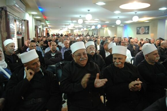 Druze supporters of Ayman Odeh cheer on the Joint Arab List at a campaign event in Yirka, a Druze village in the Galilee in northern Israel, Friday March 13, 2015. (Photo: Allison Deger)
