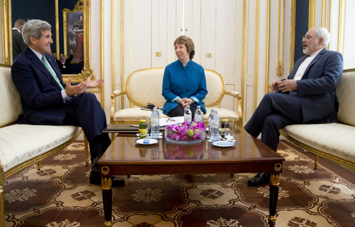 From left, U.S. Secretary of State John Kerry, European Union High Representative Catherine Ashton, and Iranian Foreign Minister Mohammad Javad Zarif are photographed as they participate in a trilateral meeting in Vienna, Austria, Wednesday, Oct. 15, 2014. (AP Photo/Carolyn Kaster, Pool)