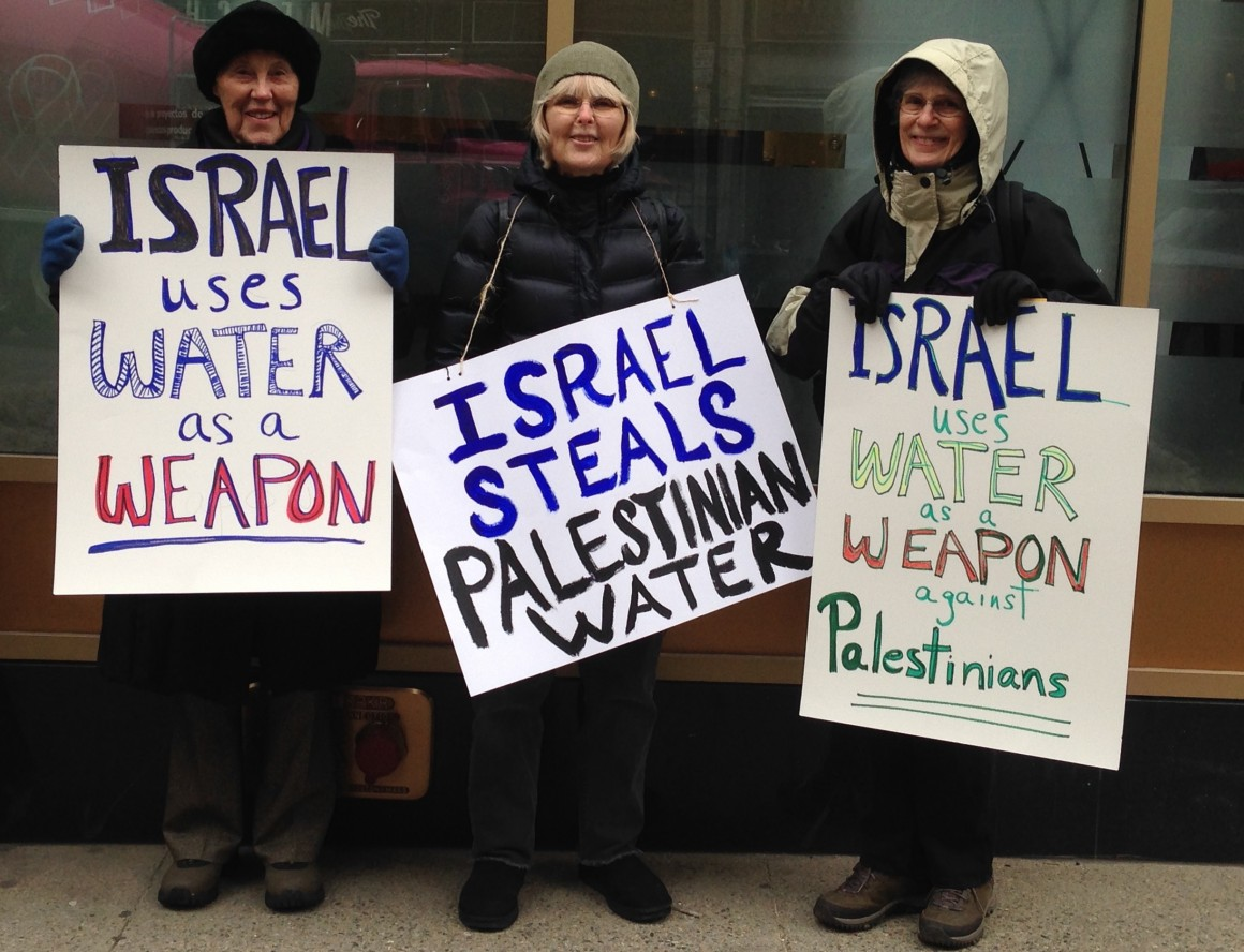 Demonstration outside the MassCEC office, where the Massachusetts-Israel Water Partnership is housed. (Photo: Heike Schotten)