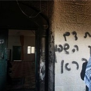 Hebrew graffiti vowing revenge against Arabs, on a mosque, a year ago in the West Bank, from Ma'an