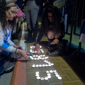 As attendees filed into the Combatants for Peace event, Kahanists lit a candle display outside the venue that commemorate what they claim are Zionists fighters killed since 1860. (Photo: Dan Cohen)