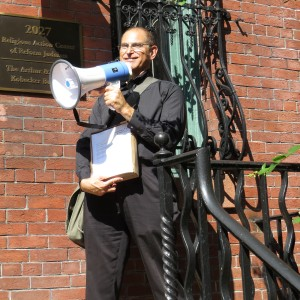 Seth Morrison delivers a petition against the Gaza war to the Religious Action Center in Washington, D.C. (Photo courtesy of Seth Morrison)