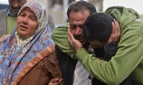 (L) Subhiya Abu Rahme during the funeral for Bassem Abu Rahme, 2009. (Photo: Muhammed Muheisen/AP)
