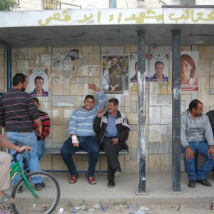 Palestinians sit outside of a mosque in Bil'in, the West Bank, during a memorial service for Bassem Abu Rahme and Palestinian Prisoners Day, Friday April 17, 2015. (Photo: Allison Deger)